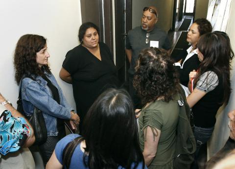 Tenant Luisa Luna, who is facing eviction from her apartment in downtown Los Angeles, answer questions from journalists.