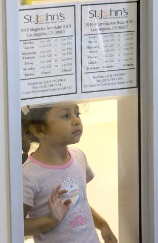 A young visitor waits in the St. John's clinic in Magnolia Place, which also currently includes a childcare facility and legal assistance offices for the local community.