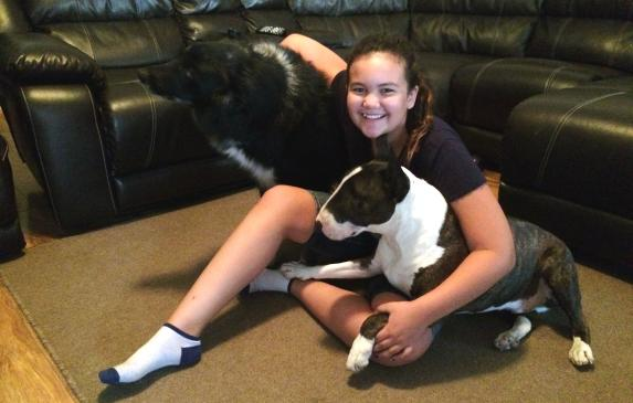 Eleven-year-old Faith Herrod, recovering from valley fever, plays with Moses, Ninja and her other four pets when she has the ene