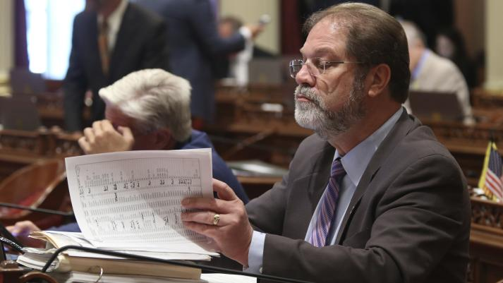 State Sen. John Moorlach, R-Costa Mesa, looks over a stack of papers