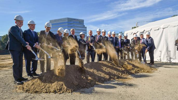 Officials hold ceremonial shovels as during a groundbreaking ceremony for the Be Well regional mental health hub in Orange, CA,