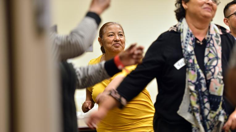 OCR-L-PREVENTIVE-0514-01: Gloria Huerta joins others as they exercise during a diabetes preventive group meeting at UCI Health