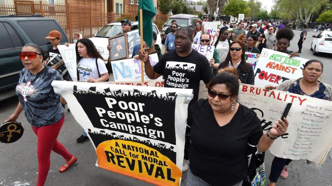 Members of the California Poor People's Campaign march in Fresno on Monday, April 8, 2019, to raise awareness on poverty.