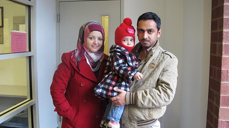New refugees from Iraq (left to right) Mazyad Noor, daughter Maryann, Abdulrahmam Marwan prepare to to go to the Squirrel Hill Health Center for their first physical.