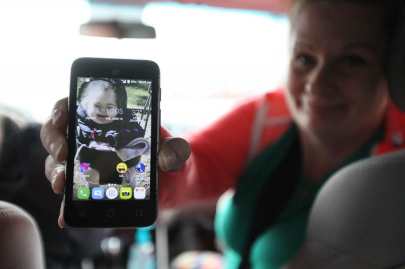 In March, on the way to a methadone clinic in Everett, Washington, Parent-Child Assistance Program client NaVey Skinner shows a photo of her daughter, who is in foster care. (Giles Bruce, The Times)