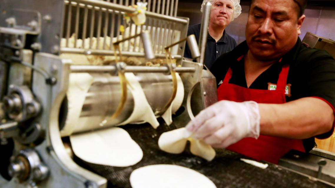 Brigham Young University professor Michael Dunn, left, works with Rancho Markets' Jorge Morales to make tortillas fortified with folic acid in Provo, Utah. Dunn is conducting experiments that could lead the Food and Drug Administration to allow fortification of corn masa — a staple grain in Hispanic diets. (Erika Schultz / The Seattle Times)