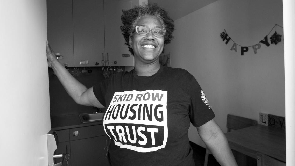 Evelyn Hilliard, formerly homeless on skid row, greets visitors at her studio in Star Apartments.