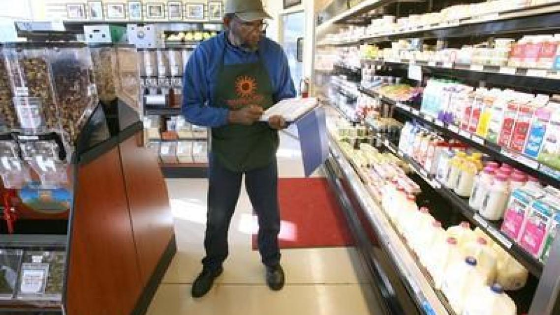 Dennis Terry takes inventory at the Mandela Food Cooperative on Seventh Street in west Oakland, Calif., on Wednesday.