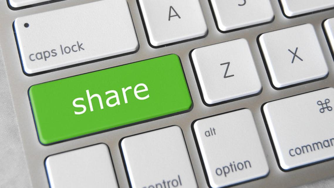 "(Image of keyboard with ""Share"" key)"