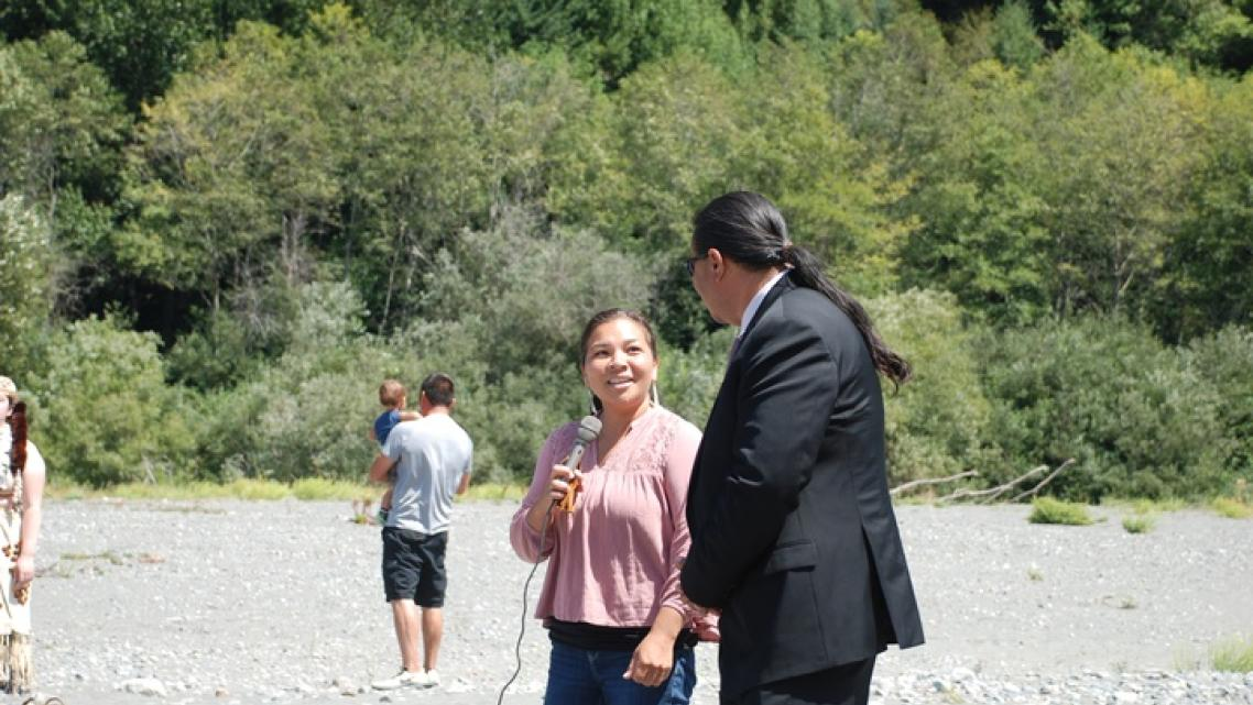 Victoria Carlson and Javier Kinney sing a Brush Dance song during a celebration at the mouth of Blue Creek on Monday.