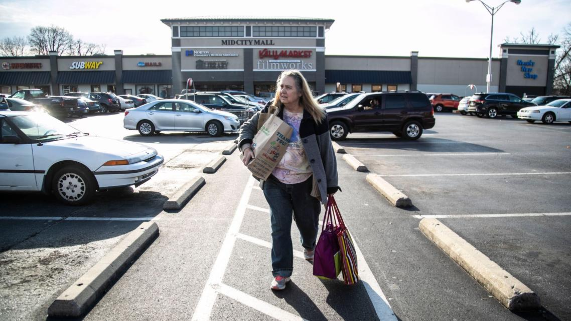 Michele Dutcher takes a bus to and from the Valumarket at the Mid City Mall on Bardstown Road a few times a week for groceries.