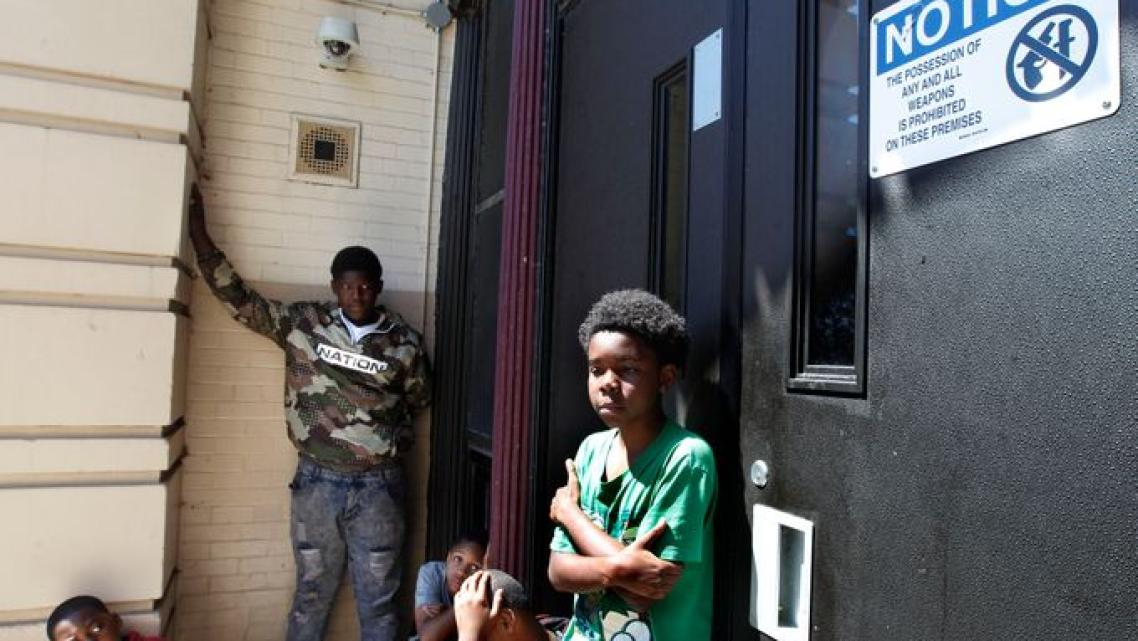 """A youth shares his story about violence during a breakout session at the """"We Got This"""" program in June. Other boys in the group"""