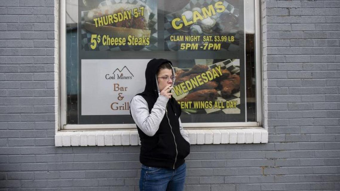 Alicia Kachmar takes a puff from her cigarette outside of Coal Miners Bar & Grill. (Photo: Rick Kintze/The Morning Call)