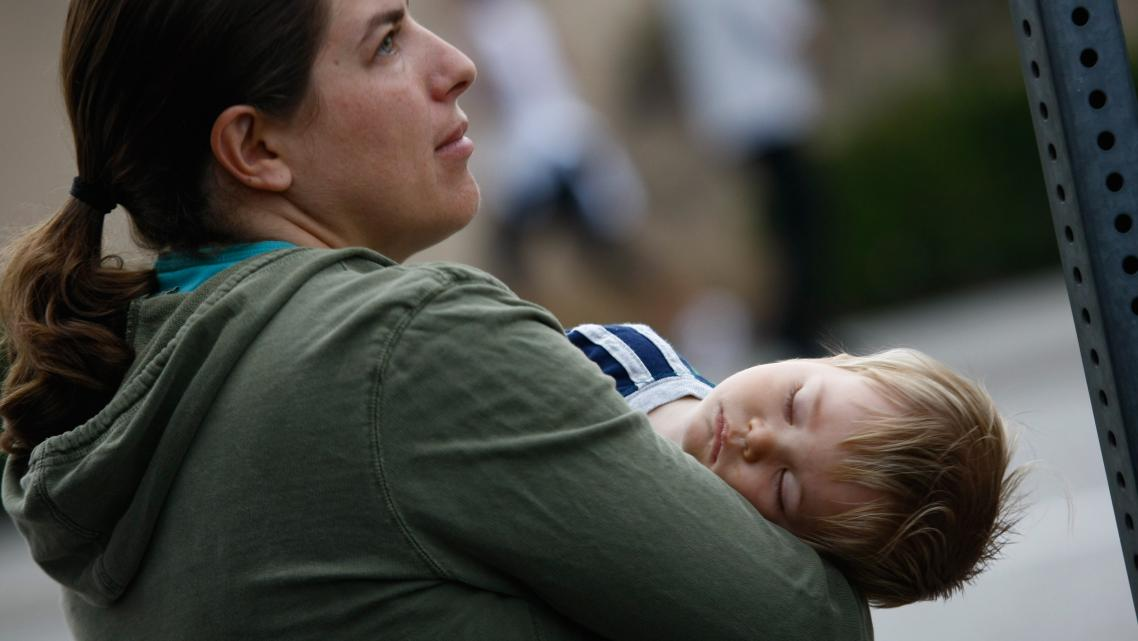 An uninsured mother and her son wait at a free health clinic in Inglewood, California.