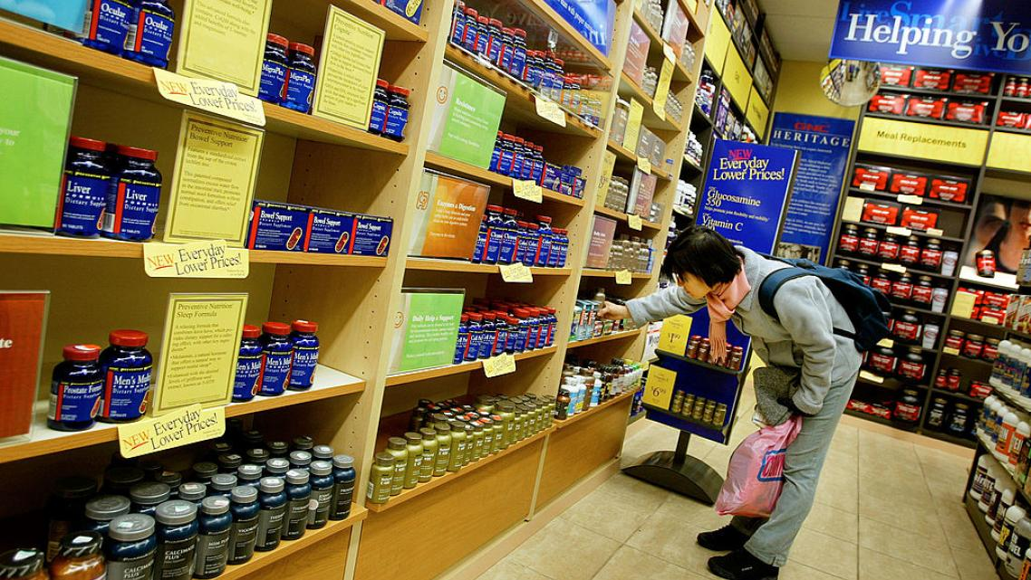 A shopper browses supplements at a GNC vitamin store in New York City.