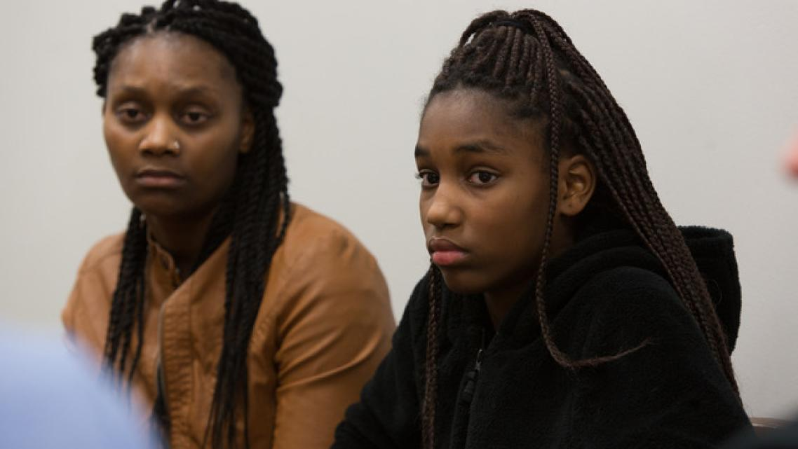 Connie White, left, and her daughter, Lataevia Gaskin, listen during a Restorative Justice Louisville meeting in January 2018. (