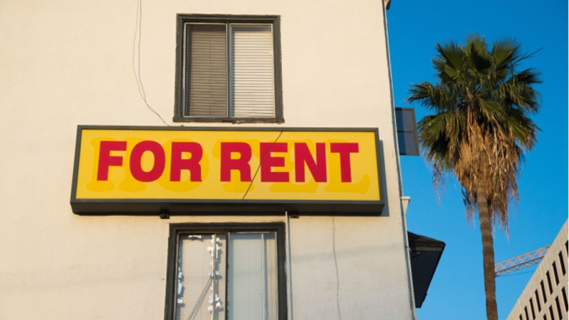 """A """"For Rent"""" sign is seen on a building Hollywood, California."""