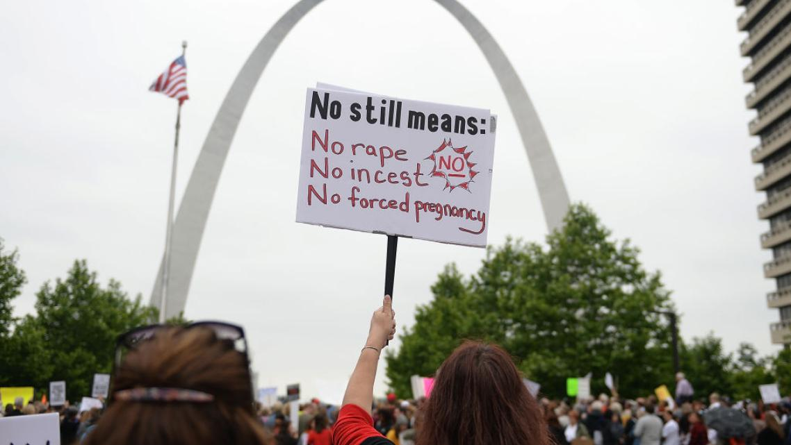 A demonstrator displays a sign during a protest rally over recent restrictive abortion laws on May 21 in St Louis, Missouri. (Ph