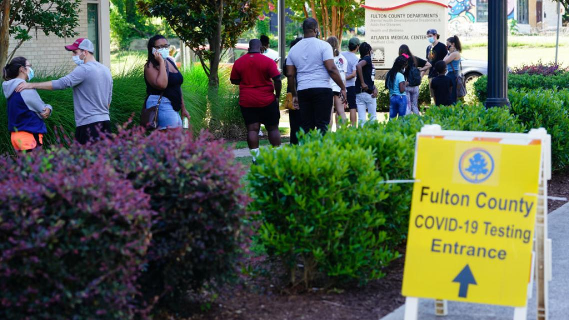 People stand in line to get tested for COVID-19 at a free walk-up testing site on July 11, 2020 in Atlanta, Georgia