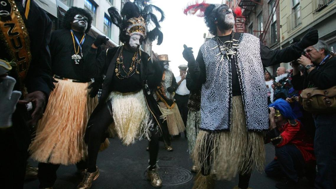 Members of the Zulu Social Aid and Pleasure Club dance in the French Quarter during Mardi Gras festivities in New Orleans