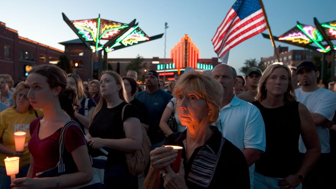 Dea Deujsch (C) participates in a candle light vigil for Dr. George Tiller in Old Town May 31, 2009 in Wichita, Kansas. Dr. Geor