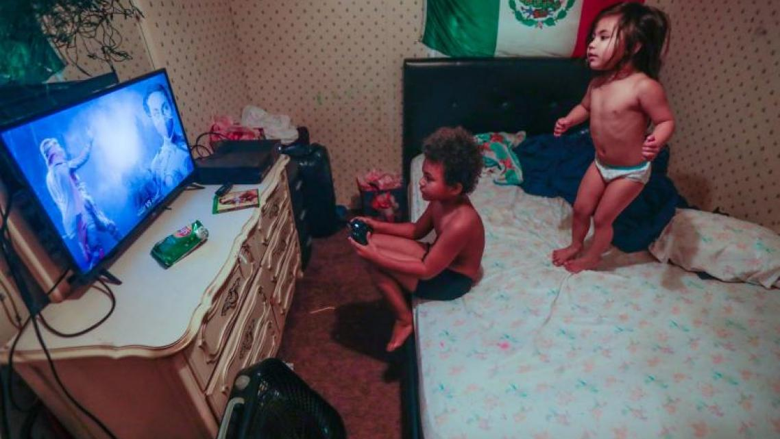Romeo, 8, and his sister Victoria, 3, play in their mobile home. The family was among those profiled in the reporter's series on