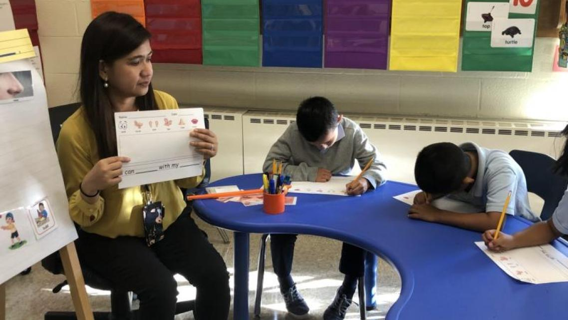 "Tanya Gan Lim teaches a ""newcomer class"" in Maryland's Prince George's County school district."
