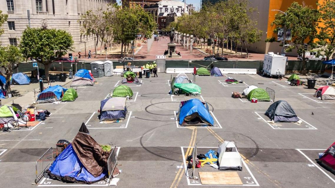Rectangles painted on the ground to encourage homeless people socially distance at a city-sanctioned homeless encampment