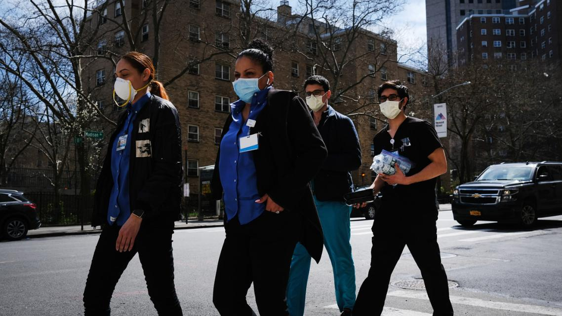 Medical workers outside of Mount Sinai Hospital in New York City. GETTY IMAGES