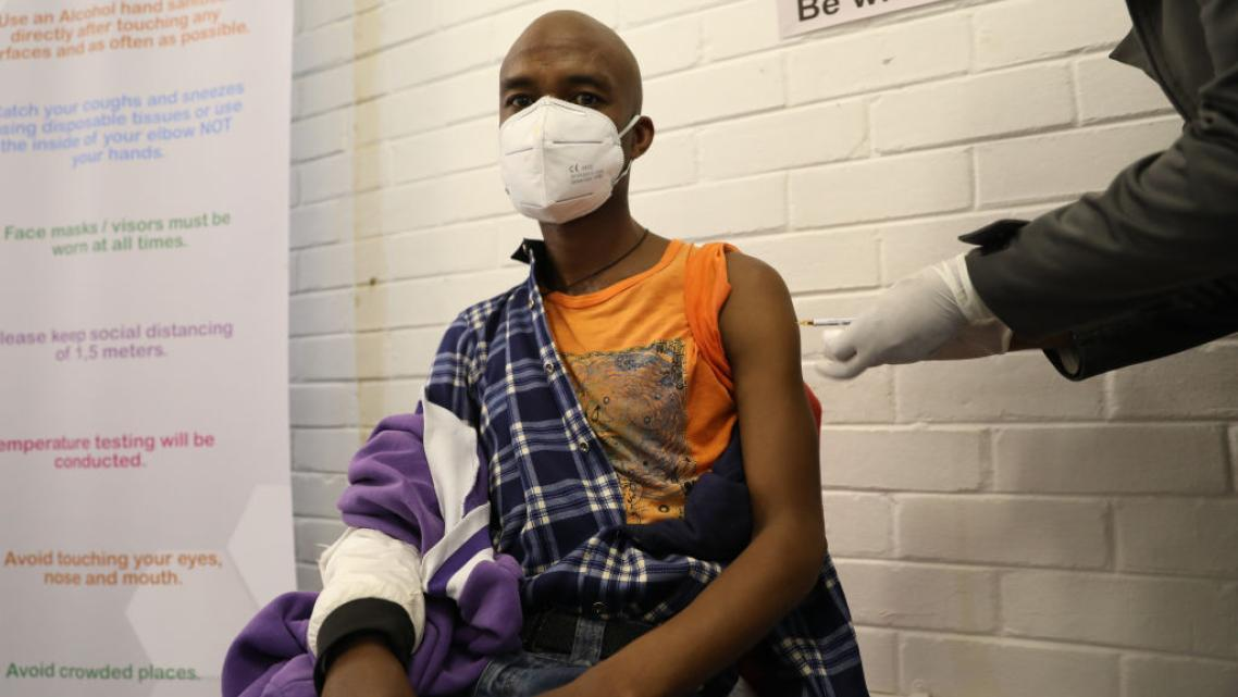 A volunteer participating in Oxford's COVID-19 vaccine trial receives a shot in South Africa on June 24.