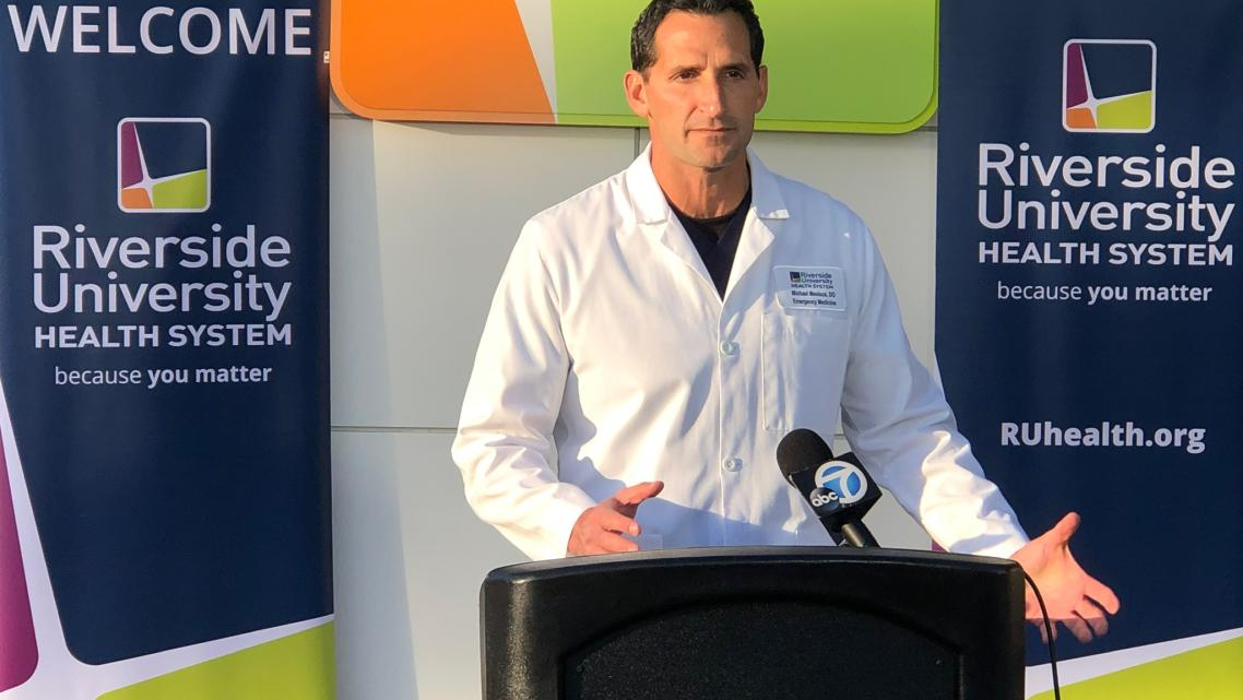 Dr. Michael Mesisca speaks at a news conference during the quarantine at March Air Reserve Base in California's Riverside County