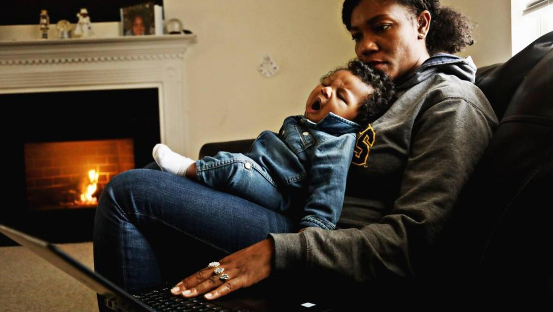 Richard yawns in mom Jessica Murrell Berryman's lap as she works remotely from the family's Durham home Dec. 6, 2019.