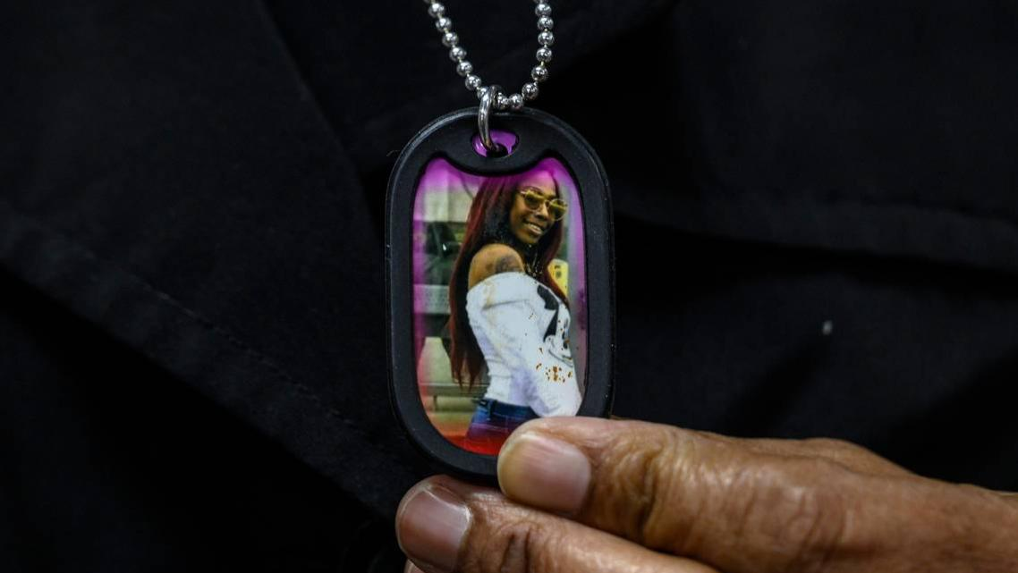 Lorrie Johnson wears a necklace with a picture of her late granddaughter Dajha Richards.