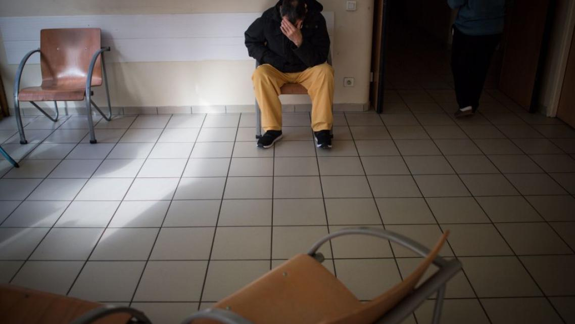 Man seated in clinic waiting room