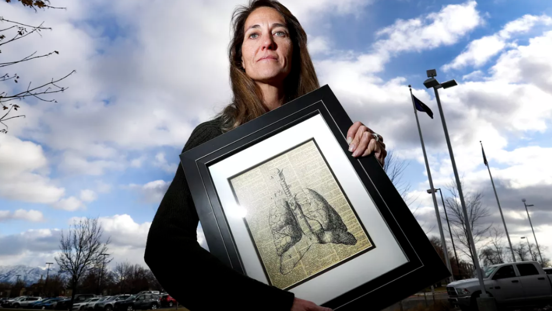 Eleanor Divver, radon project manager for the Utah Department of Environmental Quality, holds a favorite illustration of lungs.