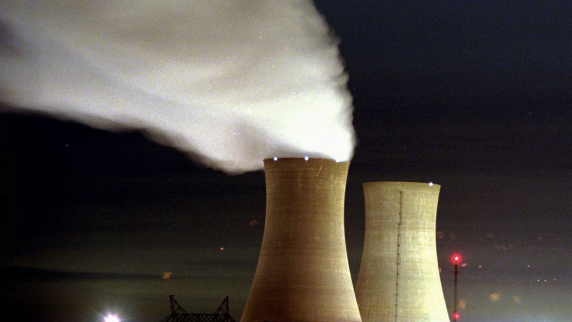 Clouds spew from a cooling tower at PECO's nuclear generating station.