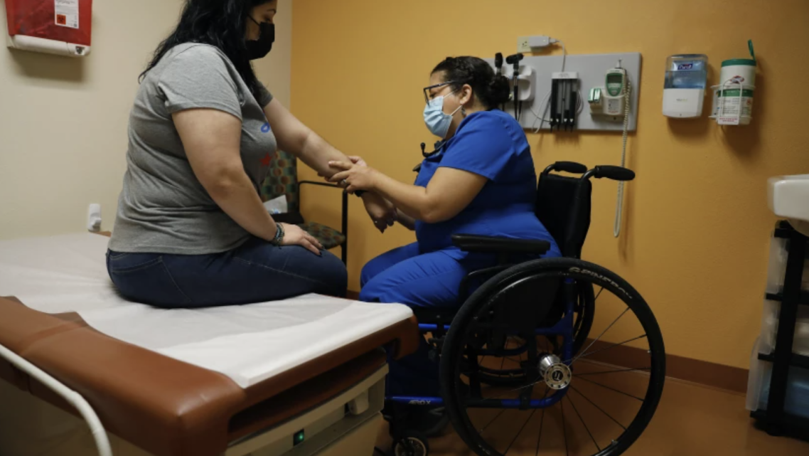 Dr. Marie Flores examines patient Karla Olguin, 35, at the AltaMed clinic in Pico Rivera.