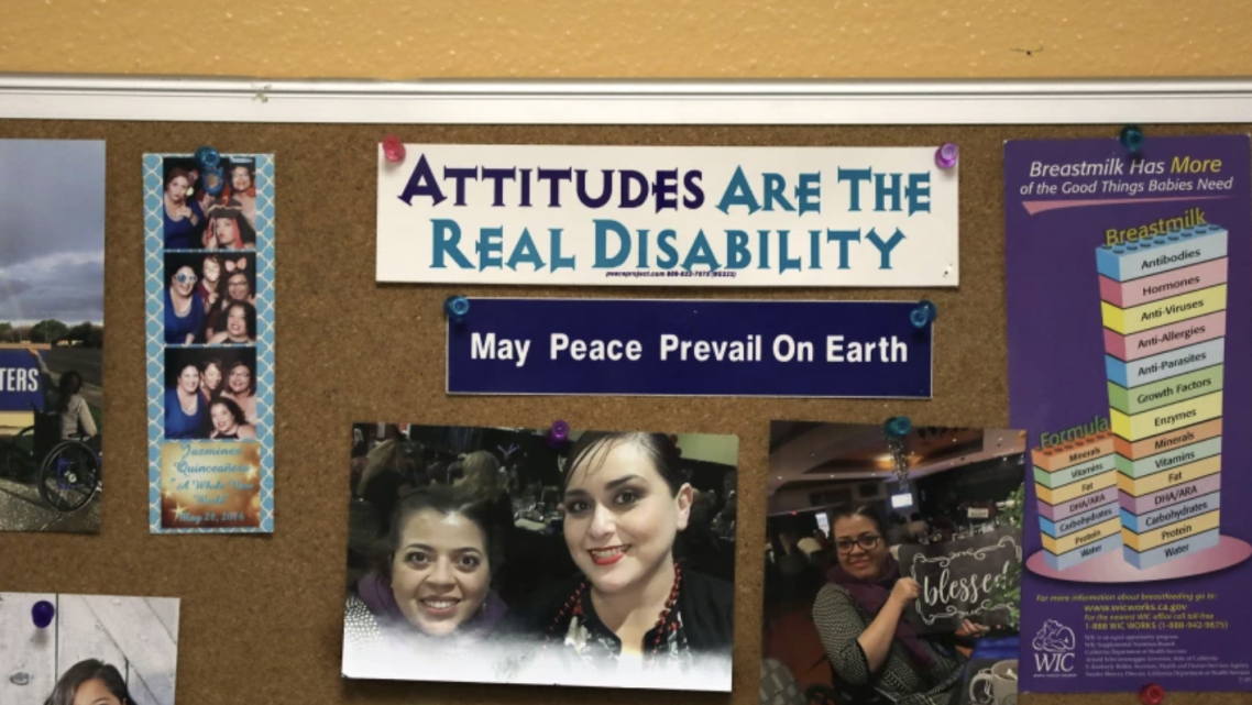 """A bulletin board inside Dr. Marie Flores' office at an AltaMed clinic in Pico Rivera features the words """"Attitudes are the Real"""