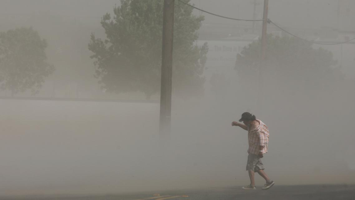 Photo credit: Craig Kohlruss/Fresno Bee: Dust storms like this one that blasted Fresno in June can carry millions of spores fromthe fungus that causes Valley Fever.