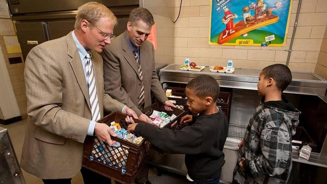 Dr. Brian Wansink, left, visits elementary students in Ithaca, New York. Revelations about Wansink's research methods led to his