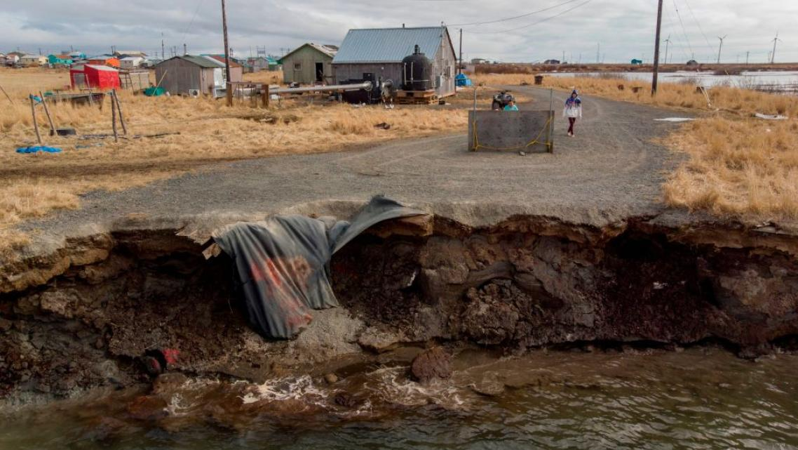 Erosion caused by melting permafrost tundra and the disappearance of sea ice threatens houses from the Yupik Eskimo village