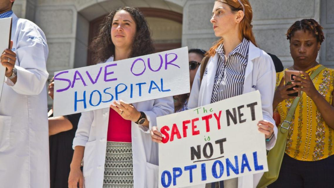 Employees, city officials, and unions rallied against the closing of Hahnemann hospital in Philadelphia in 2019.