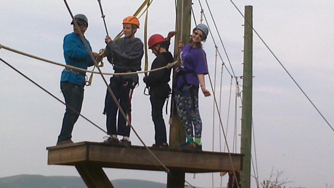 Taylor Gaydon (R), 15, ziplines with friends at the Diabetic Youth Foundation's diabetes camp in Livermore, a place where kids can have fun while learning to manage their disease.