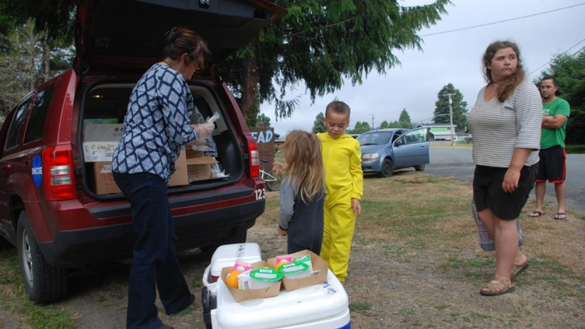 Deborah Kravitz gives breakfast to 6-year-old Mateo Rodriguez and his 4-year-old sister AnnaLee in Klamath Glen.