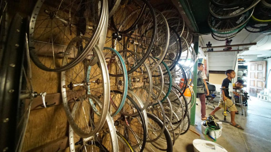 Before COVID-19 started spreading in Hawaii, kids worked on their bikes at KVIBE in Kalihi. The bike shop became a food hub when