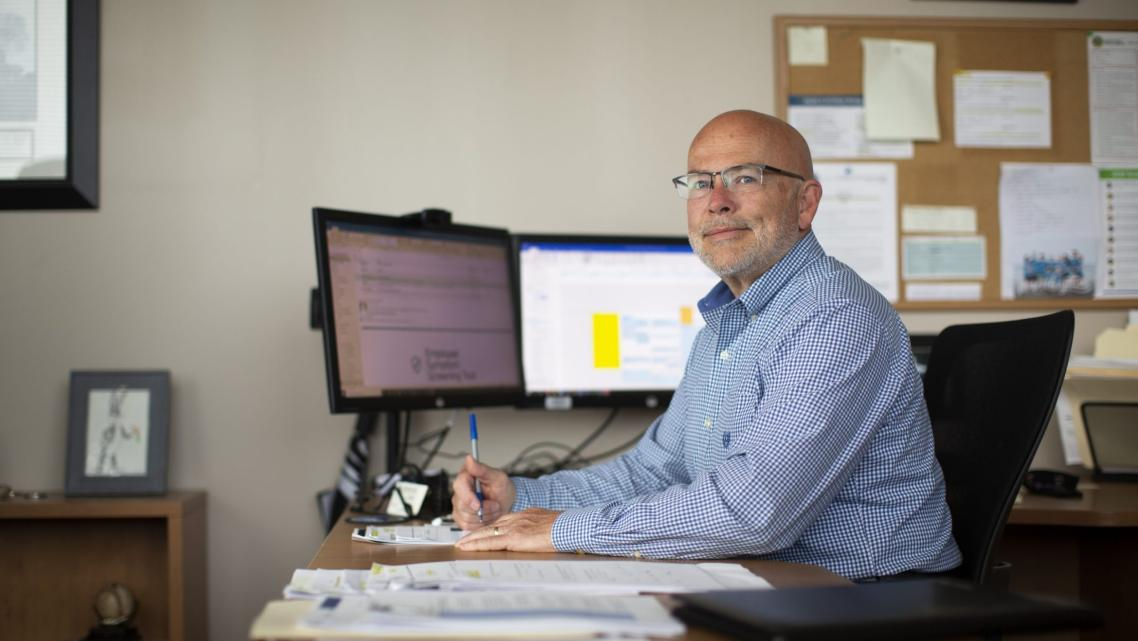 Buncombe County Health and Human Services Director Stoney Blevins sits at his desk in Asheville.