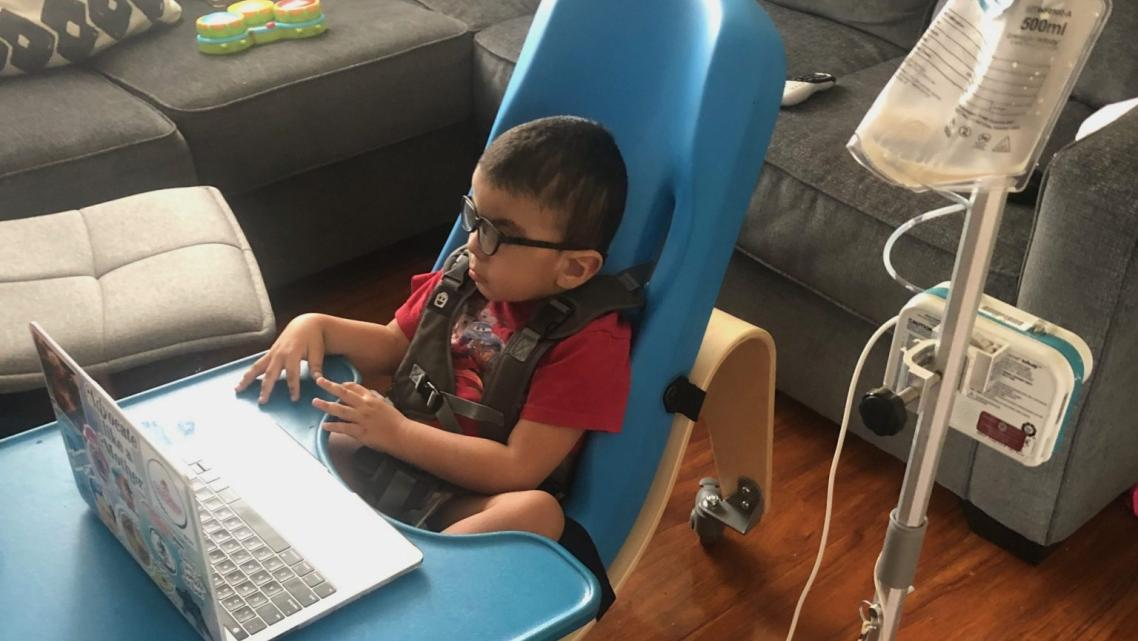 Gavin Alcala, 3, of Los Angeles participates in an online class through his day care, Centro de Niños