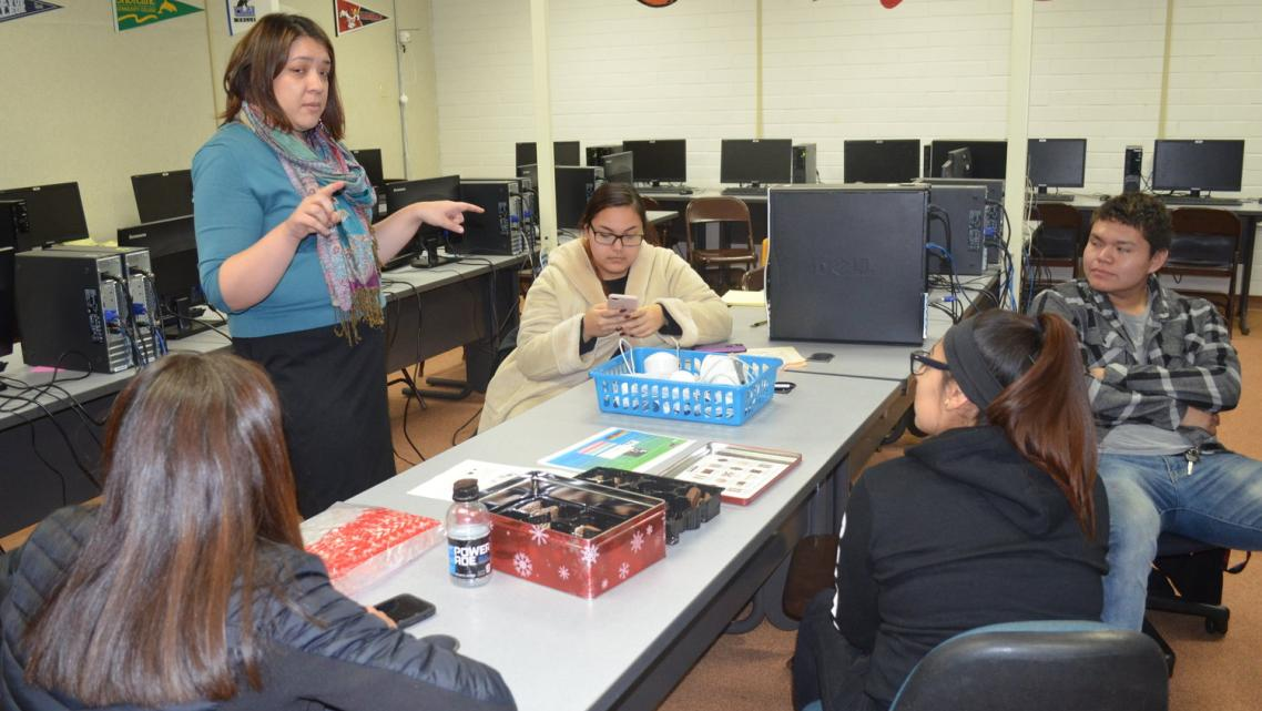 Karolynn Tom, who works with Jessica Black at Heritage University, is teaching students how to set up air quality monitors.