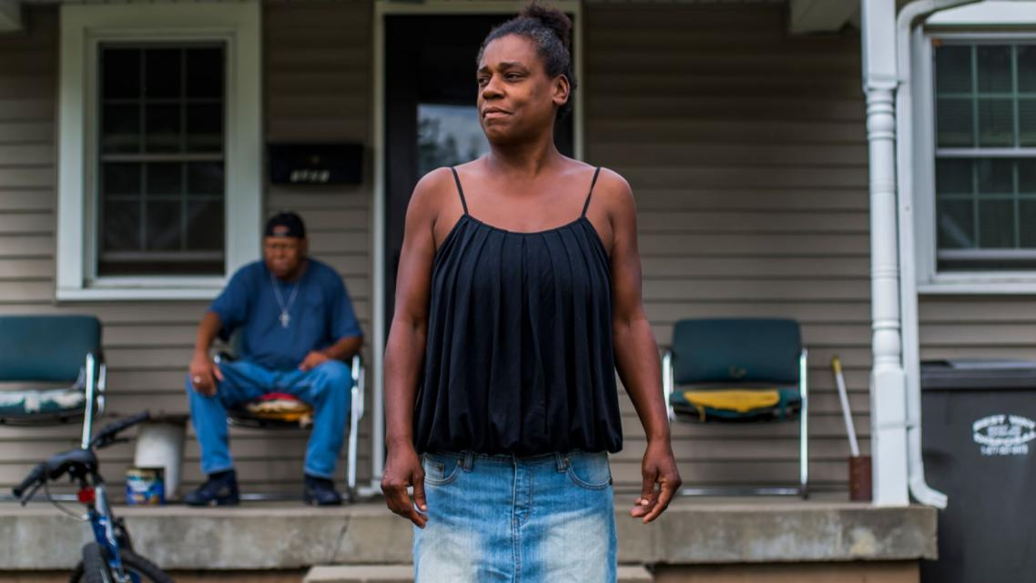 Ashley's biological mother Kim Guiden stands in front of her home in Anderson, Indiana, in 2017.