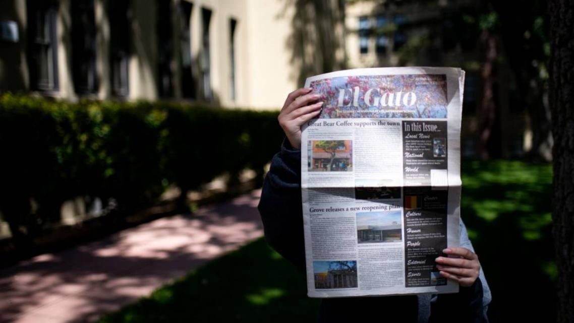Alaina Fox holds a copy of El Gato, the student newspaper of Los Gatos High School, at the school campus in Los Gatos on July 21